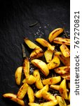 roasted potato wedges with... | Shutterstock . vector #767270821