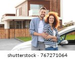 happy young couple near car   Shutterstock . vector #767271064