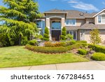 custom built house with front... | Shutterstock . vector #767284651