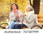 senior woman with cane and... | Shutterstock . vector #767287999