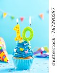 Small photo of Tenth 10th birthday cupcake with candle and sprinkles. Card mockup.