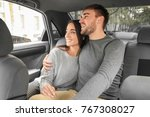 happy young couple on back seat ... | Shutterstock . vector #767308027