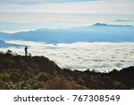 a man looking at the other hill ... | Shutterstock . vector #767308549
