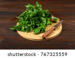 a bunch of green parsley on a... | Shutterstock . vector #767325559