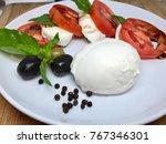 italian salad with mozzarella... | Shutterstock . vector #767346301