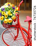 red painted bicycle with a... | Shutterstock . vector #76735726