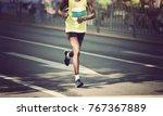 marathon runner legs running on ... | Shutterstock . vector #767367889