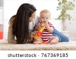 happy mother playing musical... | Shutterstock . vector #767369185