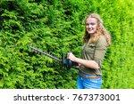 caucasian teenage girl pruning... | Shutterstock . vector #767373001