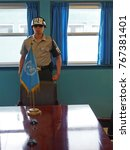 Small photo of Panmunjeom, South Korea - June 14, 2014: A soldier stands in a United Nations building on the exact border between North Korea and South Korea.