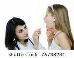 Small photo of An image of doctor looking at a child's tonsils