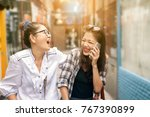 couples of asian woman laughing ... | Shutterstock . vector #767390899