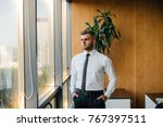 the office manager is standing... | Shutterstock . vector #767397511