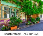 cozy street with tables of cafe ... | Shutterstock . vector #767404261