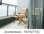 empty chair in balcony and... | Shutterstock . vector #767427721