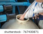 filling sand into sand filter... | Shutterstock . vector #767430871