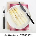 Dutch white asparagus served with a light cheese sauce and pepper - stock photo