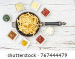 french fries in frying pan with ... | Shutterstock . vector #767444479
