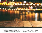 image of wooden table in front... | Shutterstock . vector #767464849