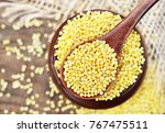 spoon of millet on wooden...   Shutterstock . vector #767475511