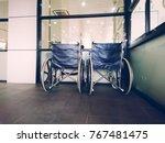empty wheelchair parked in... | Shutterstock . vector #767481475
