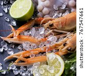 raw langoustine  mussels and... | Shutterstock . vector #767547661