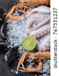 raw langoustine  mussels and... | Shutterstock . vector #767551237