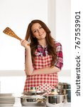 woman cooking  holding kitchen... | Shutterstock . vector #767553901