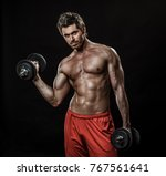 handsome muscular man with bare ... | Shutterstock . vector #767561641
