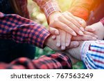 group holding together as... | Shutterstock . vector #767563249