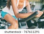 indoor cycling woman doing hiit ... | Shutterstock . vector #767611291