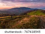 wooden fence on a grassy rural... | Shutterstock . vector #767618545