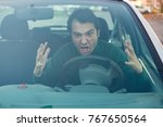 angry man driver pissed off by... | Shutterstock . vector #767650564