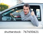 portrait of angry driver at the ... | Shutterstock . vector #767650621