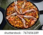 typical spanish food  paella. | Shutterstock . vector #767656189