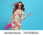 fashion young woman in floral... | Shutterstock . vector #767658331