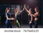 sport women giving high five... | Shutterstock . vector #767660125
