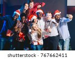 girls and guys in santa hats... | Shutterstock . vector #767662411
