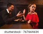 quarrel of couple in restaurant ... | Shutterstock . vector #767664634