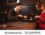 love couple eating in...   Shutterstock . vector #767664949