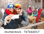 young cheerful couple taking... | Shutterstock . vector #767666017