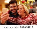 happy couple taking selfie... | Shutterstock . vector #767668711
