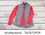 red pullover and gray vest on... | Shutterstock . vector #767672929