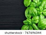 Fresh Green Basil On A Wooden...
