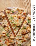 Small photo of Pizza with porcini (cep) mushrooms, onion and leek shot from above