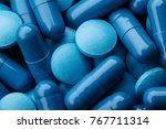 Close Up Of Blue Pills Capsule...