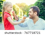 father and daughter walk... | Shutterstock . vector #767718721