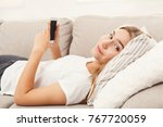 young woman at home messaging... | Shutterstock . vector #767720059
