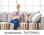 young person with dog at home... | Shutterstock . vector #767720911