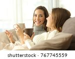 two happy roommates talking in... | Shutterstock . vector #767745559